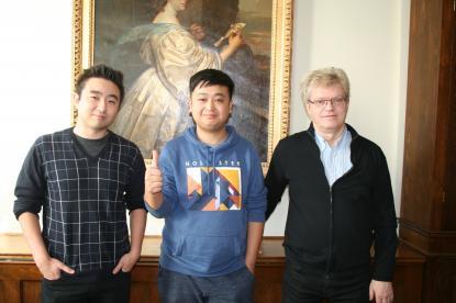 Stefan Olsson, Li Chang och Christer Zeeck som anvarar för utbytet med Beijing
